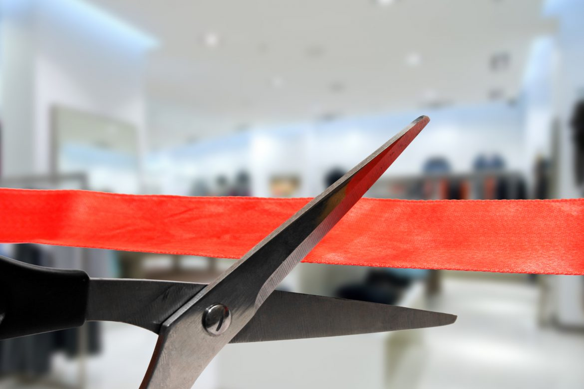 shop grand opening - scissors cutting red ribbon